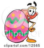 Sink Plunger Mascot Cartoon Character Standing Beside An Easter Egg by Toons4Biz