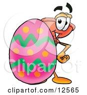 Sink Plunger Mascot Cartoon Character Standing Beside An Easter Egg