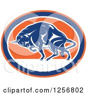 Clipart Of A Retro Woodcut Charging Angry Bison In A Blue Orange And White Oval Royalty Free Vector Illustration