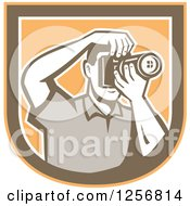 Clipart Of A Retro Male Photographer Taking Pictures In An Orange Brown And White Shield Royalty Free Vector Illustration
