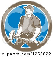 Clipart Of A Retro Union Worker Carrying A Sledgehammer In A Brown White And Blue Circle Royalty Free Vector Illustration by patrimonio