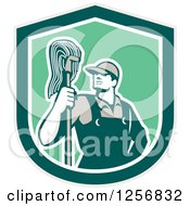 Clipart Of A Retro Male Janitor With A Mop In A Green Shield Royalty Free Vector Illustration