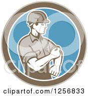 Retro Male Construction Worker Rolling Up His Sleeve In A Brown White And Blue Circle