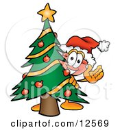 Clipart Picture Of A Sink Plunger Mascot Cartoon Character Waving And Standing By A Decorated Christmas Tree by Toons4Biz