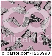 Clipart Of A Seamless Background Pattern Of Butterflies On Pink Royalty Free Vector Illustration
