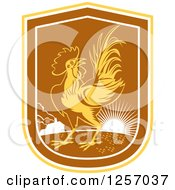 Clipart Of A Rooster In A Yellow White And Brown Sunrise Shield Royalty Free Vector Illustration by patrimonio