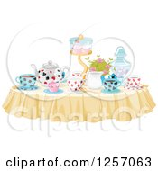 Clipart Of A Table Set With Treats And Drinks For A Tea Party Royalty Free Vector Illustration