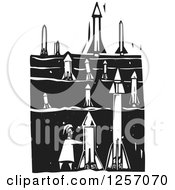 Clipart Of A Black And White Woodcut Terrorist Setting Up Missiles In A Field Royalty Free Vector Illustration