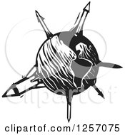 Clipart Of A Black And White Woodcut Planet Earth With Missiles Royalty Free Vector Illustration by xunantunich