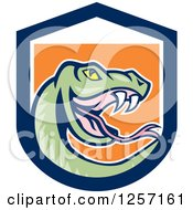 Clipart Of A Cartoon Green Rattle Snake In A Blue White And Orange Shield Royalty Free Vector Illustration