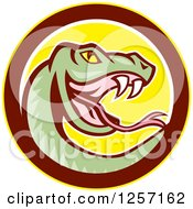 Clipart Of A Cartoon Green Rattle Snake In A Yellow Brown And White Circle Royalty Free Vector Illustration