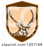 Clipart Of A Retro Woodcut Deer In A Brown And Tan Shield Royalty Free Vector Illustration