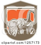 Clipart Of A Mad Elephant In A Brown White And Orange Shield Royalty Free Vector Illustration