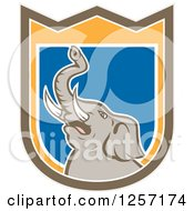 Clipart Of A Mad Elephant In A Brown Orange White And Blue Shield Royalty Free Vector Illustration