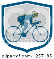 Clipart Of A Retro Male Cyclist In A Blue White And Gray Shield Royalty Free Vector Illustration