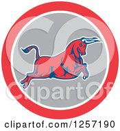 Clipart Of A Retro Charging Bull In A Red White And Gray Circle Royalty Free Vector Illustration
