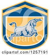 Clipart Of A Retro Charging Bull In A Blue White And Yellow Shield Royalty Free Vector Illustration
