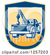 Clipart Of A Retro Tow Truck In A Yellow And Blue Shield Royalty Free Vector Illustration