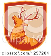 Clipart Of A Retro Deer In A Tan White Red And Orange Shield Royalty Free Vector Illustration by patrimonio