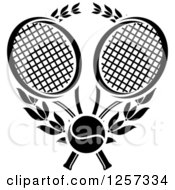 Clipart Of A Black And White Tennis Ball And Laurel Wreath With Crossed Rackets Royalty Free Vector Illustration