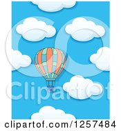 Clipart Of A Hot Air Balloon Over A Cloudy Sky Royalty Free Vector Illustration