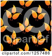 Clipart Of A Pattern Of Orange Leaves On Black Royalty Free Vector Illustration