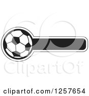 Clipart Of A Black And White Soccer Ball With A Bar For Text Royalty Free Vector Illustration by Lal Perera