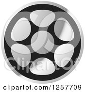 Clipart Of A Grayscale Film Reel Royalty Free Vector Illustration by Lal Perera