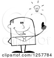 Clipart Of A Black And White Stick Businessman With A Bright Idea Royalty Free Vector Illustration
