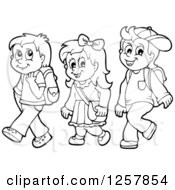 Clipart Of Three Black And White Happy School Children Walking Royalty Free Vector Illustration
