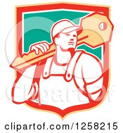 Clipart Of A Retro Locksmith Man Carrying A Giant Key In A Yellow Red White And Green Shield Royalty Free Vector Illustration by patrimonio