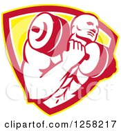 Clipart Of A Retro Muscular Male Bodybuilder Lifting Weights In A Yellow White And Red Shield Royalty Free Vector Illustration by patrimonio