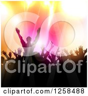 Clipart Of A Silhouetted Dancing And Cheering Crowd Over Colorful Lights Royalty Free Vector Illustration by KJ Pargeter