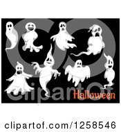 Clipart Of Ghosts With Halloween Text On Black Royalty Free Vector Illustration by Seamartini Graphics