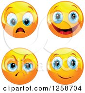 Clipart Of Worried Happy Mad And Excited Emoticons Royalty Free Vector Illustration by Pushkin