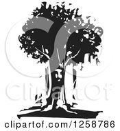 Clipart Of A Black And White Woodcut Face In A Tree Royalty Free Vector Illustration by xunantunich