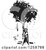 Clipart Of A Black And White Woodcut Man Holding Up A Tree Royalty Free Vector Illustration by xunantunich