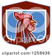 Clipart Of A Retro Woodcut Rooster In A Blue Maroon And White Shield Royalty Free Vector Illustration