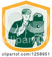 Clipart Of A Retro Male Photographer With A Bellows Camera In A Yellow White And Green Shield Royalty Free Vector Illustration