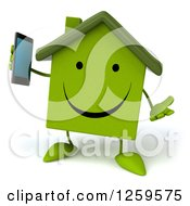 3d Green House Holding A Cell Phone