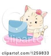 Clipart Of A Happy Beige Cat Girl Using A Laptop Computer Royalty Free Vector Illustration