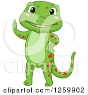Clipart Of A Cute Happy Green Gecko Giving A Thumb Up Royalty Free Vector Illustration by BNP Design Studio