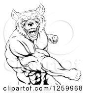 Clipart Of A Black And White Muscular Wolf Man Punching Royalty Free Vector Illustration