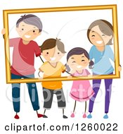 Clipart Of A Happy Stick Family Posing And Holding A Frame Royalty Free Vector Illustration