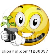 Clipart Of A Happy Emoticon Holding A Seedling Plant Royalty Free Vector Illustration