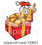 Price Tag Mascot Cartoon Character Standing By A Christmas Present by Toons4Biz