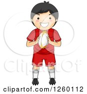 Clipart Of A Happy Asian Boy Holding A Rugby Football Royalty Free Vector Illustration