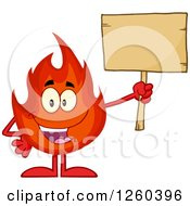 Clipart Of A Happy Fireball Flame Character Holding Up A Blank Wood Sign Royalty Free Vector Illustration