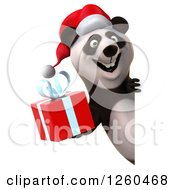Clipart Of A 3d Christmas Panda Holding A Gift Around A Sign Royalty Free Illustration by Julos