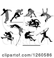 Clipart Of Black Silhouetted Male Track And Field Athletes In Action Royalty Free Vector Illustration